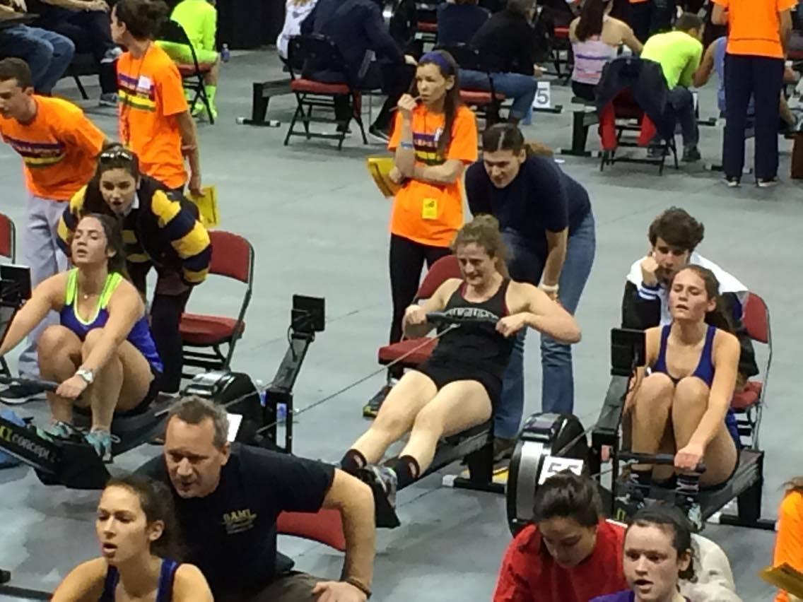 Sophomore Anne Lipsett (center) pulls as Coach Abi Kornett encourages her from behind.