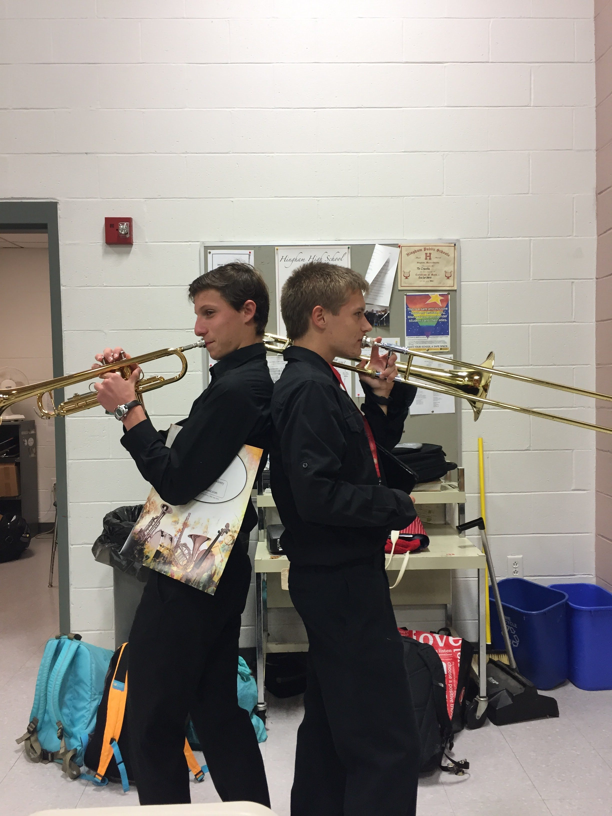 Left Junior Michael Hill and Senior Dan Carr pose back to back right before the music concert.