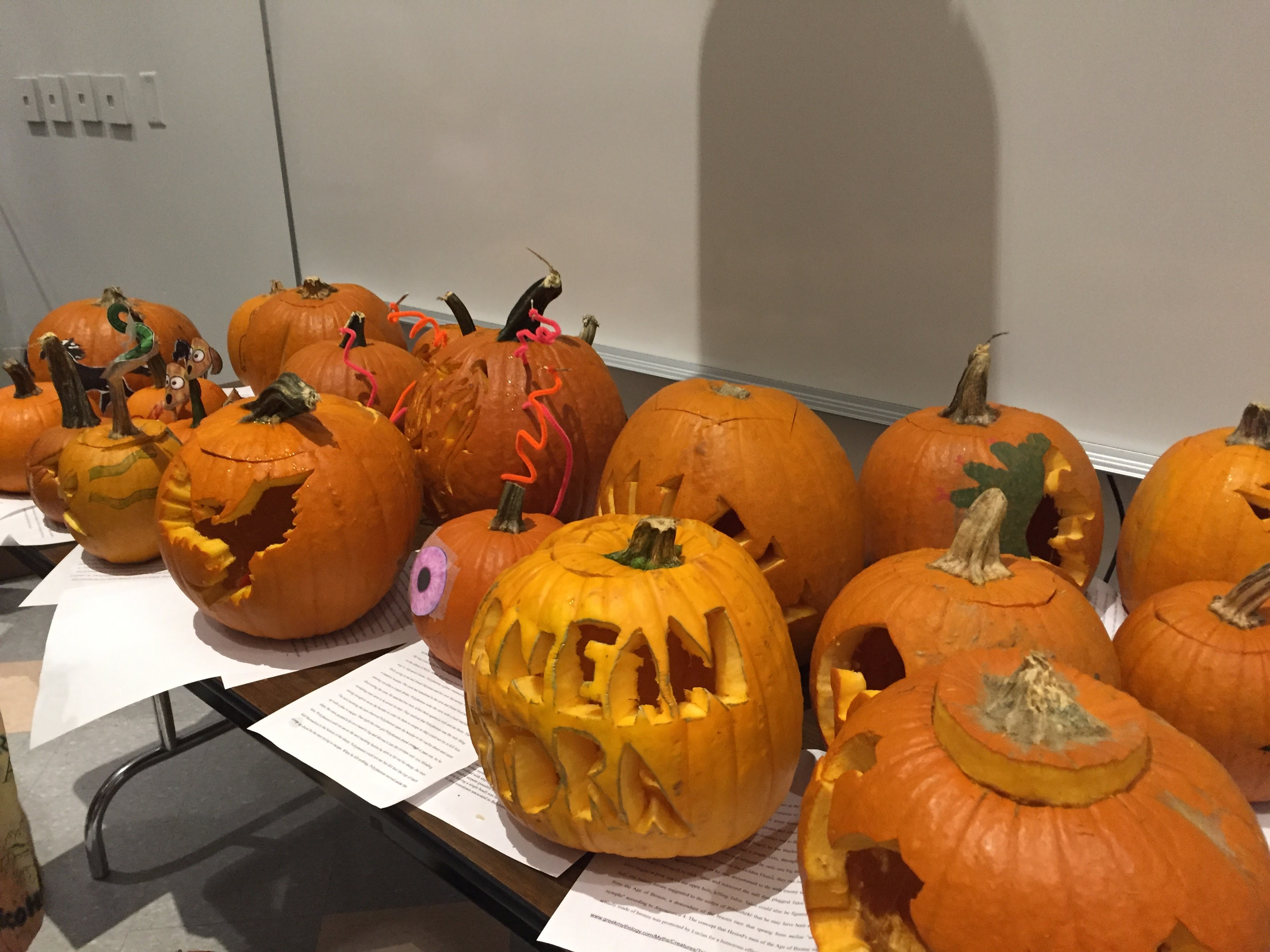 An array of artfully carved and painted pumpkins in the spirit of Halloween.