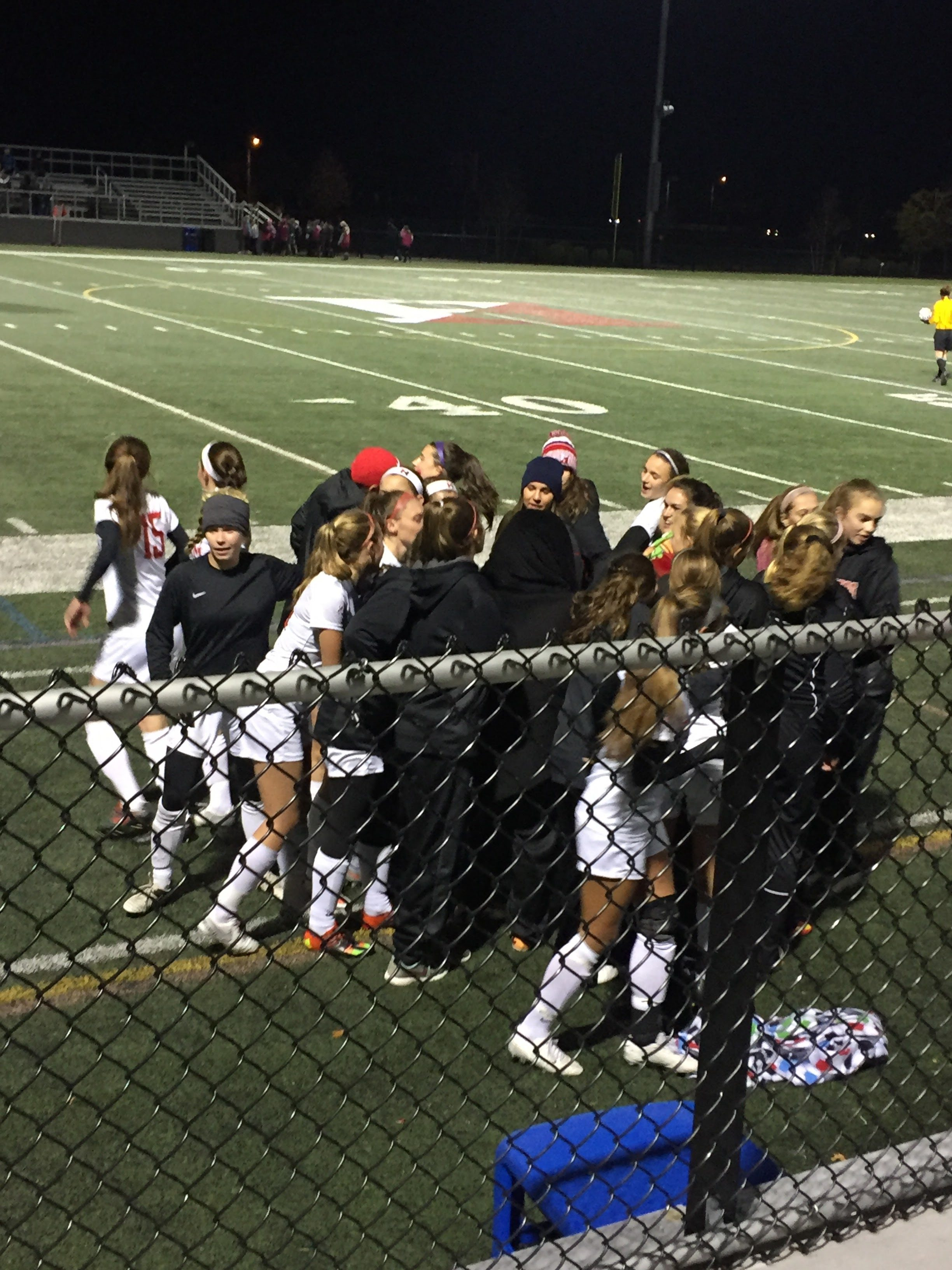 Hingham Girls break up after their cheer to the second half of the game.