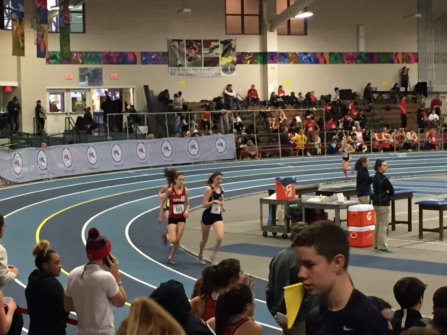Junior+Jackie+Harrington+strides+into+place+during+her+mile.+