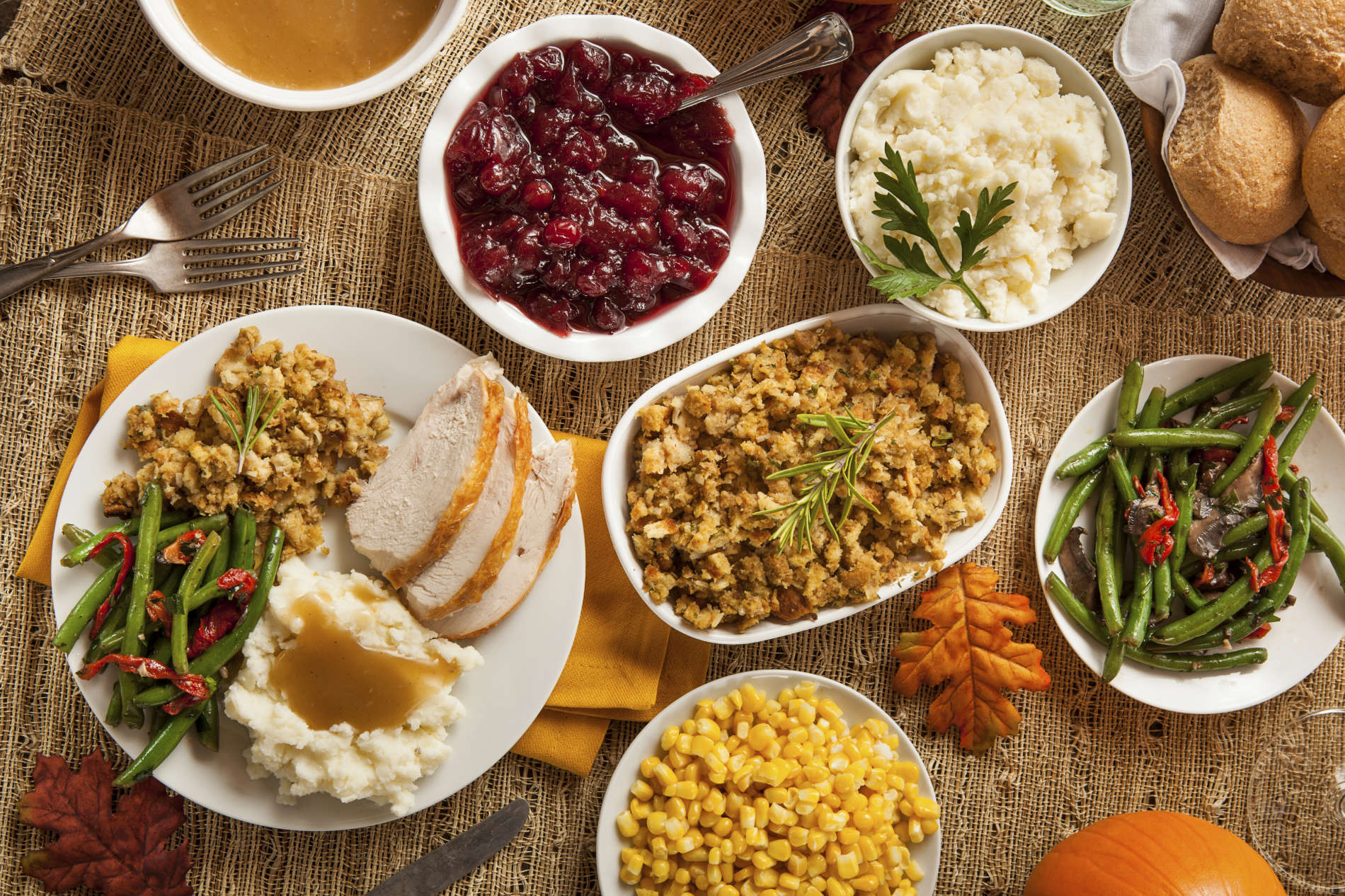 A homemade turkey Thanksgiving Dinner with mashed potatoes, stuffing, and corn.