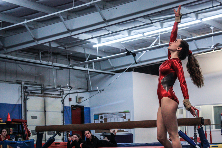 Freshman Sophie Spielberger poses at the end of her floor routine