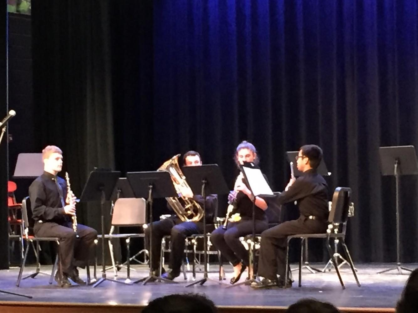 Left+to+right+freshmen+Raphael+Alexander%2C+Tim+Wagner%2C+Gwen+Johnson%2C+and+senior+Justin+Moczynski+played+a+piece+composed+by+Justin.++