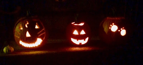 Pumpkins the author carved with her family this past Thursday to celebrate the season.