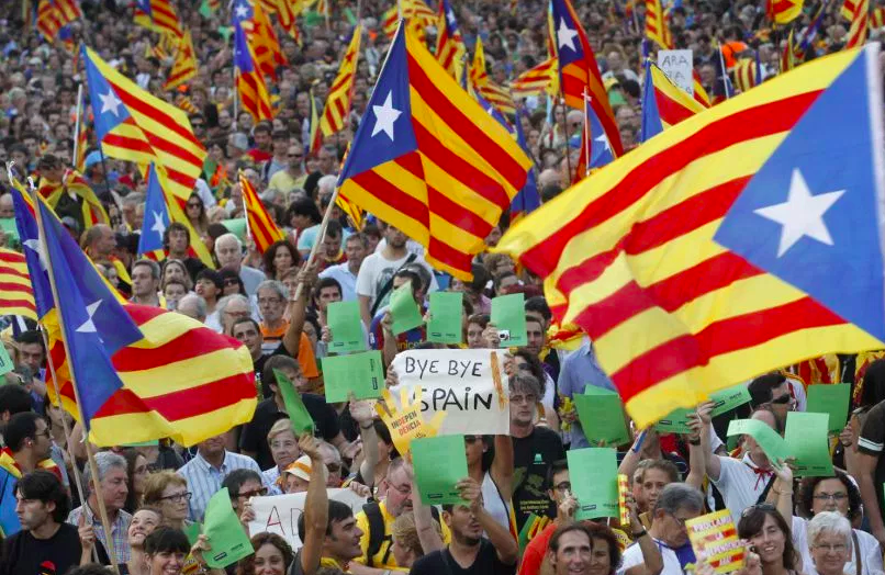 People+demonstrating+in+Barcelona+in+favor+of+Catalan+independence+with+the+Catalonia+flag+and+%22bye%2C+bye+Spain%22+posters.+%28Photo+from+The+Nation%29.