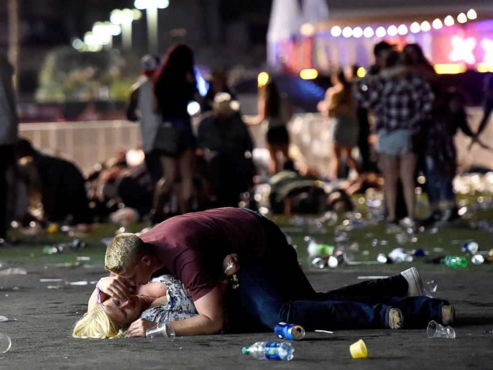 An+unidentified+man+attempts+to+console+a+victim+of+the+October+1+shooting.+The+woman+survived.+%28David+Becker%2F+Getty+Images%29