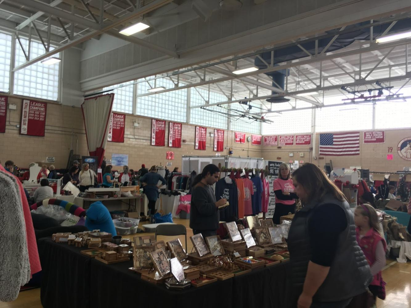 The high school's gymnasium filled with various local businesses' stands.