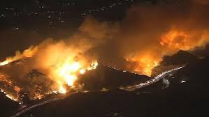 The Skirball Fire burns in the Bel Air, threatening multiple homes and buildings.  Photo via NBC Los Angeles.