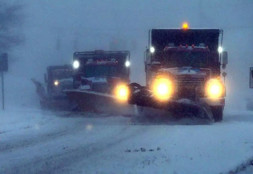 Plows+trying+to+clear+up+the+roads+for+school+starting+up+the+next+day+in+Hanover.+
