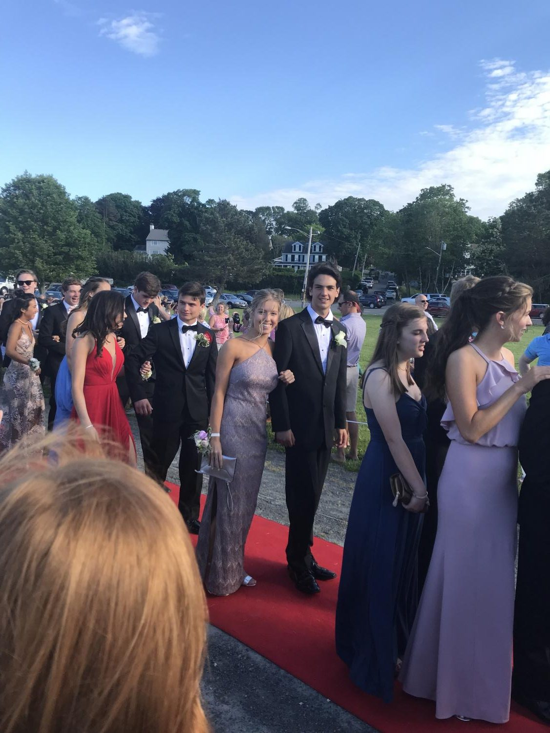 Prom-goers walking the red carpet before heading to Lombardo's where the prom itself was held.