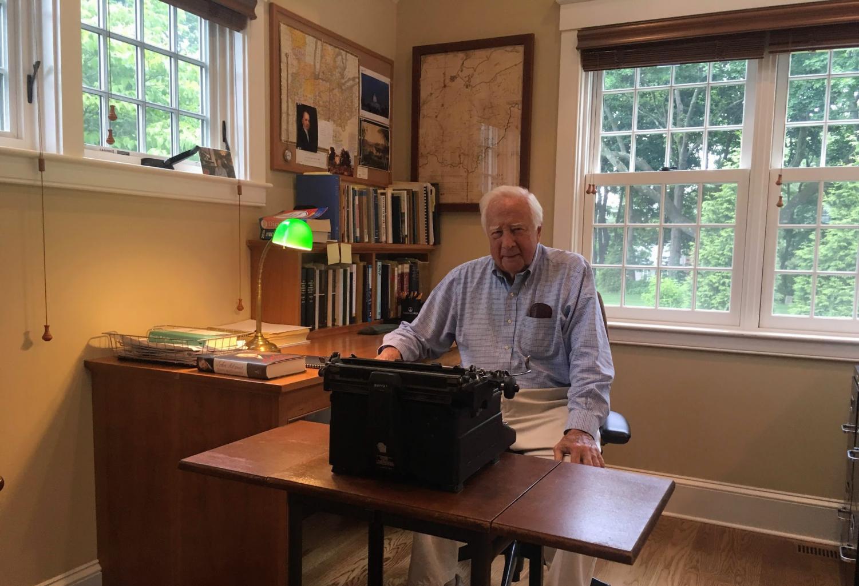 David McCullough sitting at his typewriter.