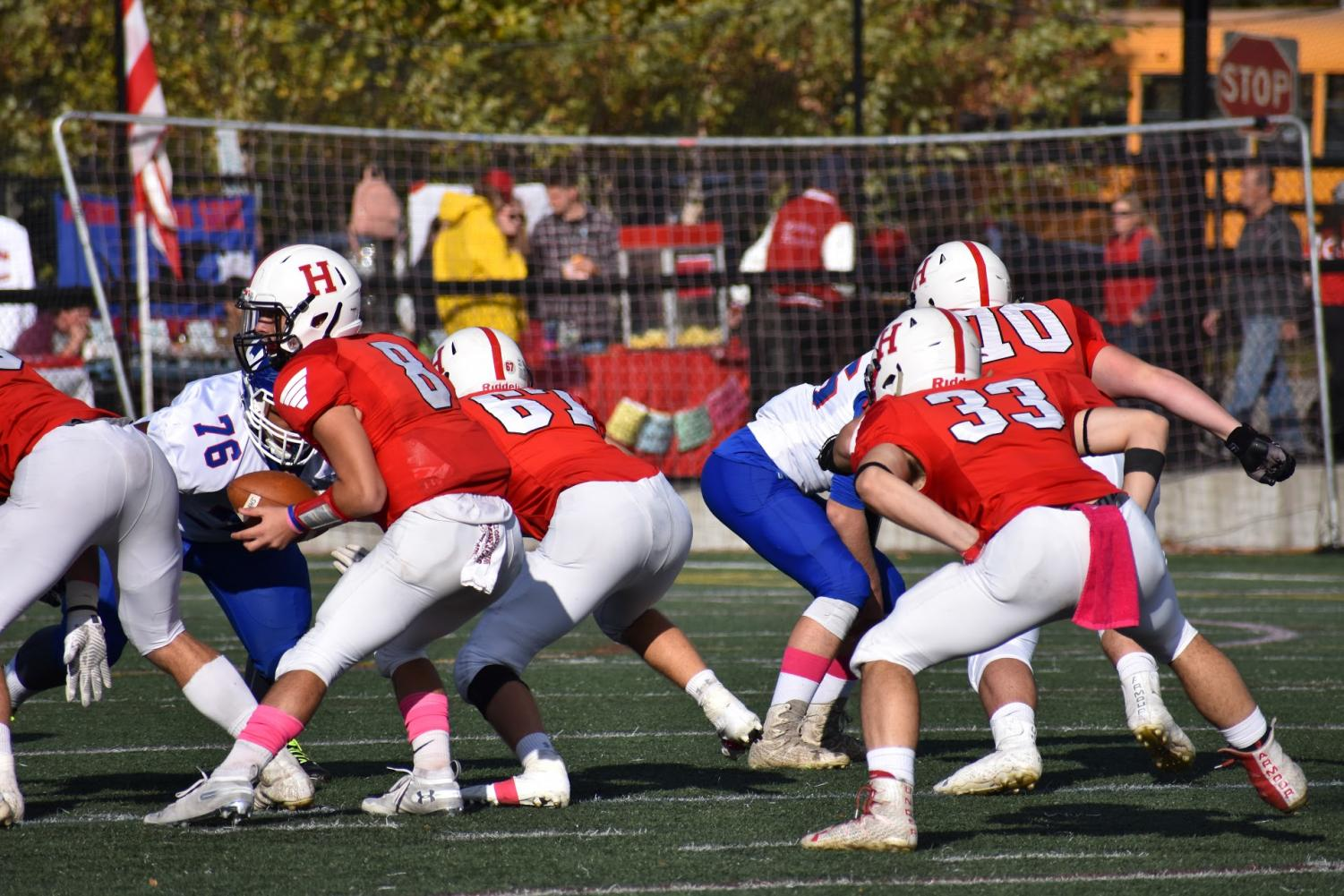 Junior Owen O'Brien takes the snap. Most of Hingham's plays were running plays, many of which going for over ten yards.