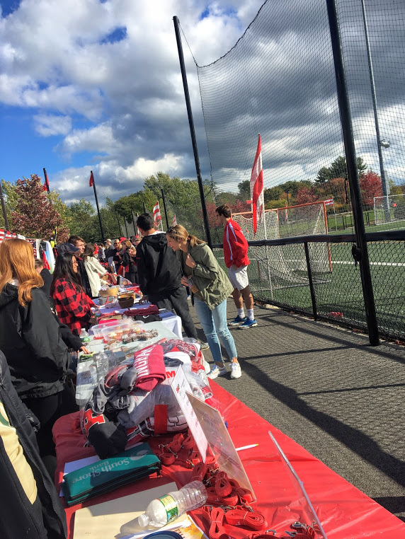 Hingham+fans+shop+at+activity+tables+on+the+outside+of+the+turf+field+during+the+girls+soccer+game+of+Homecoming.