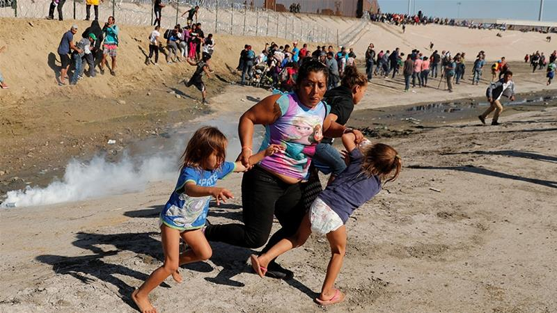 A+family%2C+including+a+mother+and+two+little+girls+in+diapers%2C+run+from+the+tear+gas+released+by+the+U.S.+Border+Patrol+at+the+U.S.-Mexico+border.