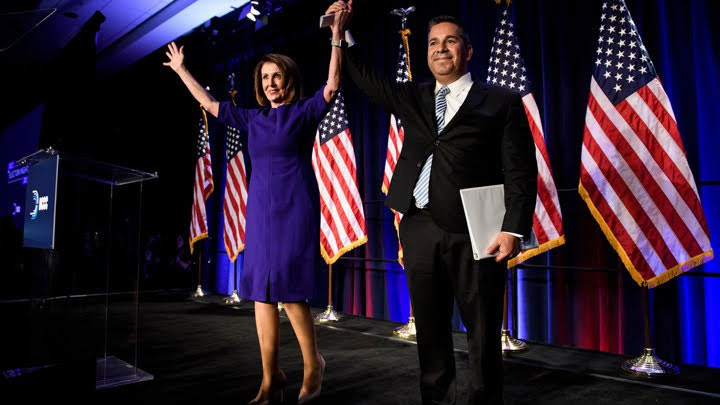 House Minority Leader Nancy Pelosi (D-CA) and Representative Ben Ray Lujan (D-MN), DCCC Chairman, celebrate a projected Democratic Party takeover of the House of Representatives during a midterm election night party hosted by the Democratic Congressional Campaign Committee on November 7, 2018 in Washington, DC. (BRENDAN SMIALOWSKI/AFP/Getty Images)