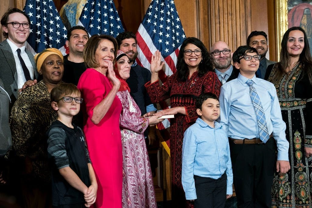 Nancy Pelosi swears in Rashida Tlaib on Jan. 3 (Doug Mills / New York Times)