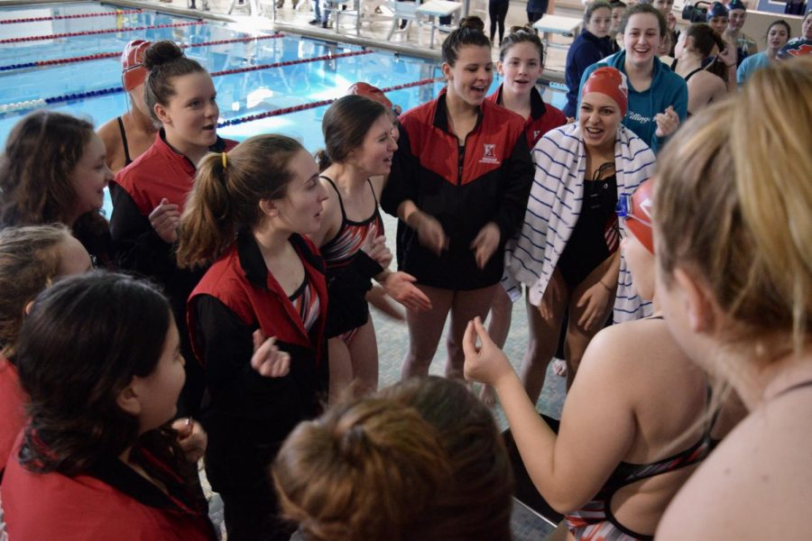 The+Girls+Swim+Team+shout+the+Hingham+Swim+and+Dive+cheer+before+the+exciting+meet+begins.+The+Cheer+was+led+by+Senior+captain%2C+Kathrine+Connolly.