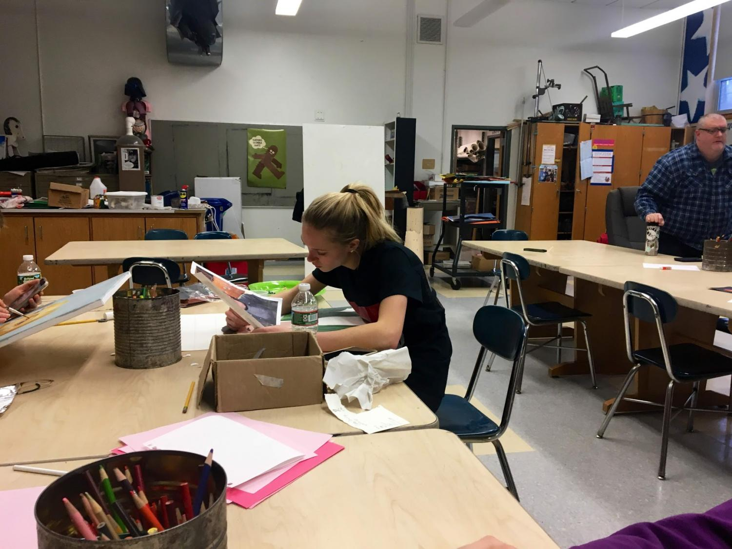 Student Peyton Belsher hard at work during an art class.