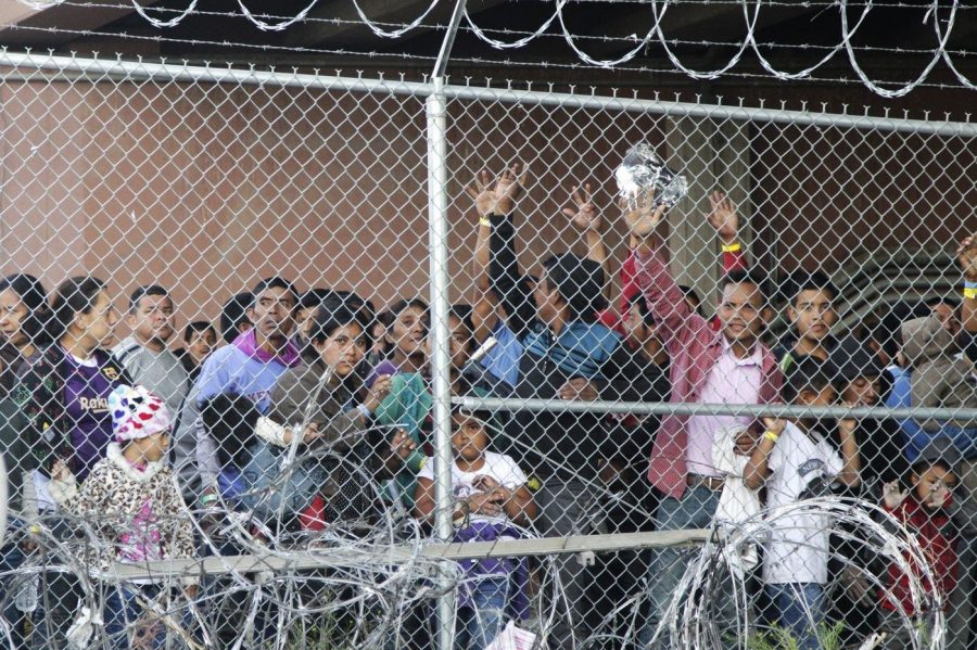 Immigrants+line+up+in+hopes+of+gaining+entrance+to+the+United+States+at+a+detention+center+in+El+Paso%2C+Texas.+Photo+by+Cedar+Attanasio+%28AP%29