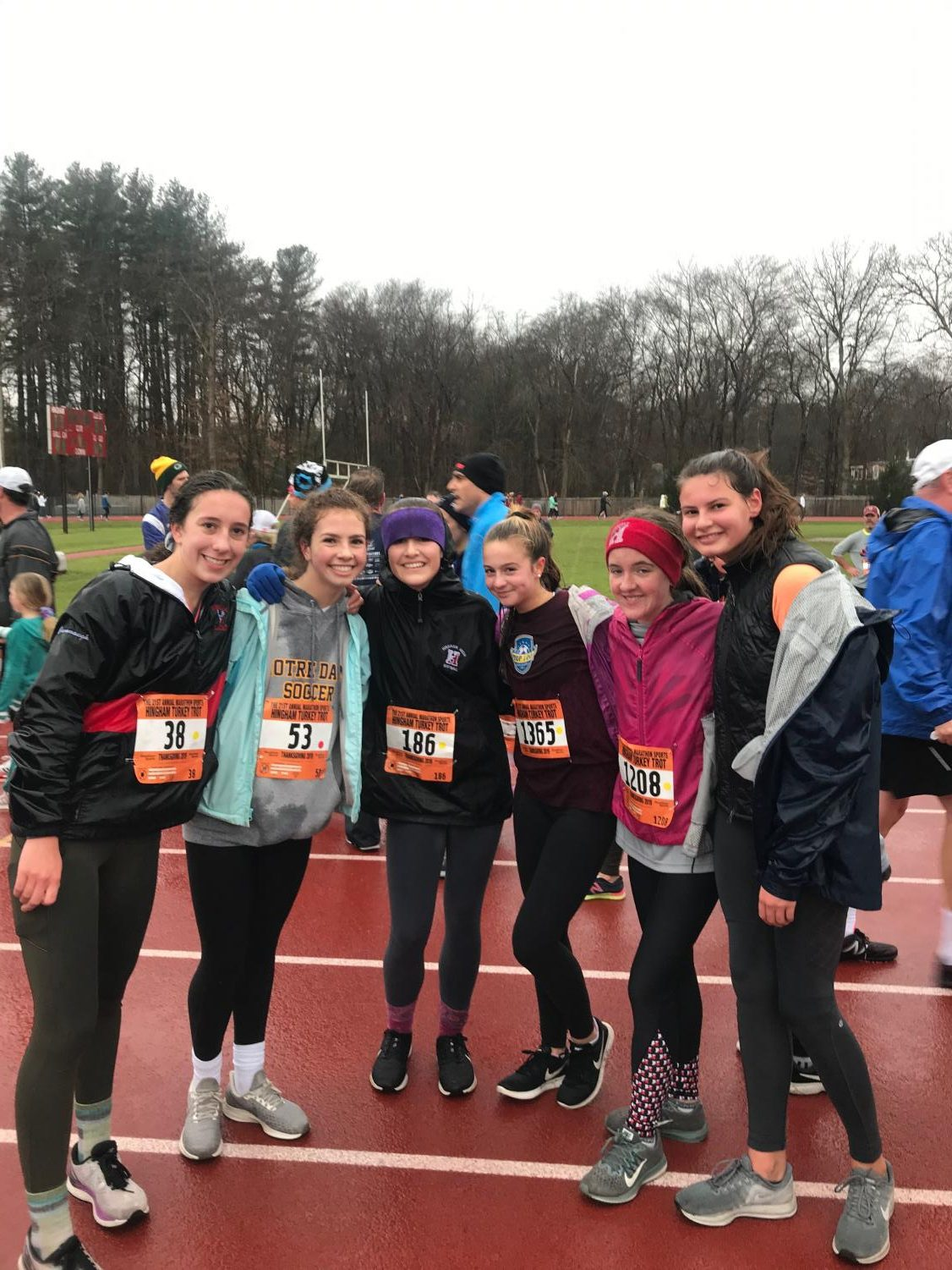 From Left: Sophomores Mila Ranocha, Molly Drew, Elle Cavanaugh, Jade Weggeman, Ava Malloy, and Camille Boer pose for a photo after finishing the trot.