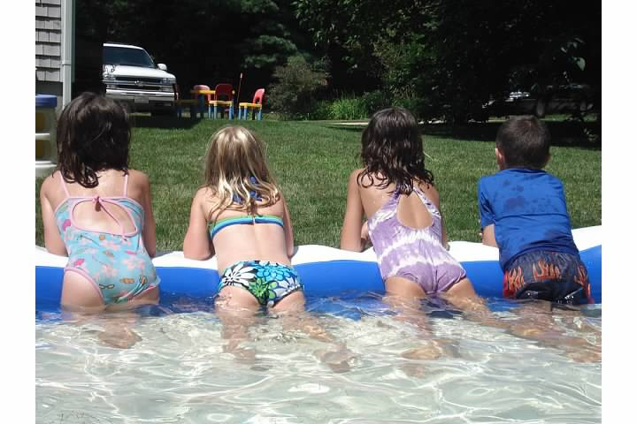 Ms. Fennelly's three children enjoy a dip in the pool.