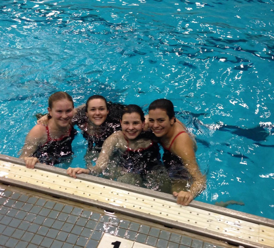 Left to Right: sophomore Maya Nielsen, senior Erin Lynch, and freshmen Katherine Connolly and Olivia Casey relax in the pool.