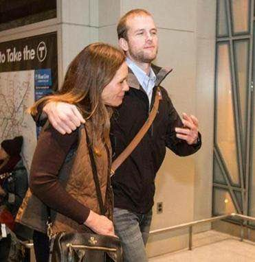Trevithick leaving Logan Airport with his mother