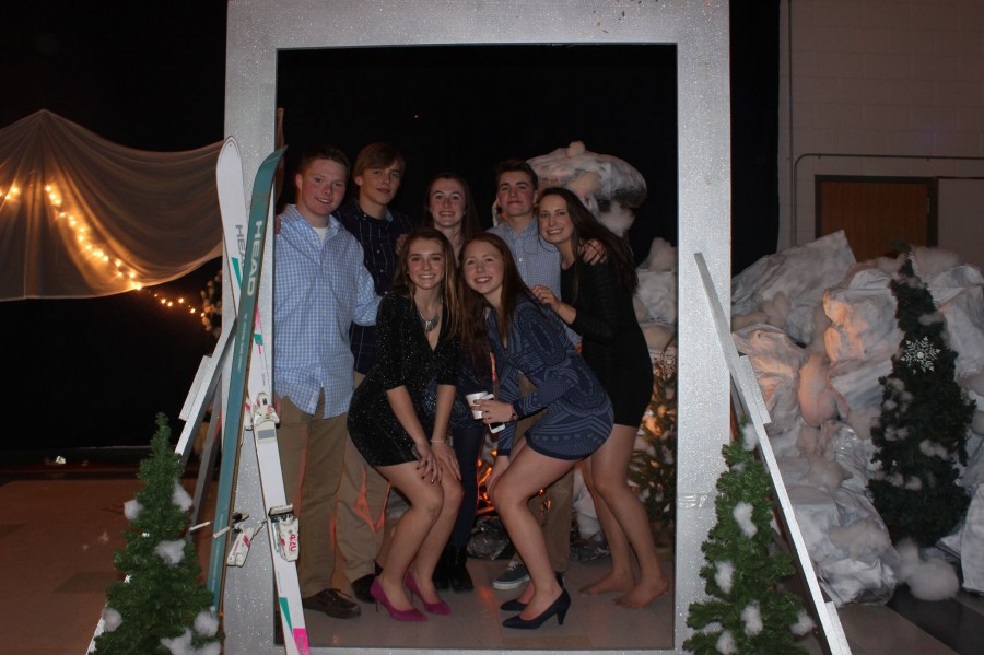 Friends pose for a picture in the photo booth.