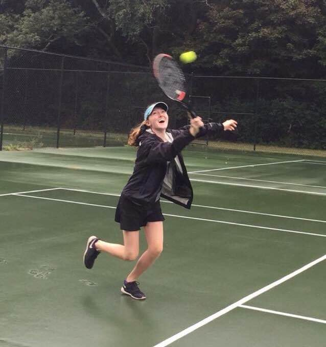 Molly Hendrickson plays tennis.
