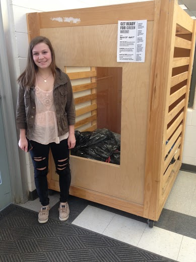 Julia Murphy proudly displays her donation bin in the HHS lobby.