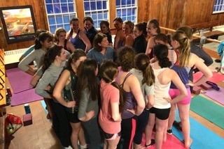 Girls+varsity+and+novice+assemble+for+yoga+in+preparation+for+the+spring+season.