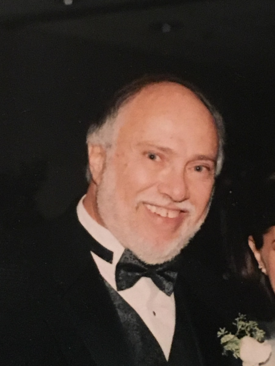Here Nelson Bauman smiles in a photograph taken at his daughter's wedding. Her ceremony      combined both the Catholic and Jewish traditions.