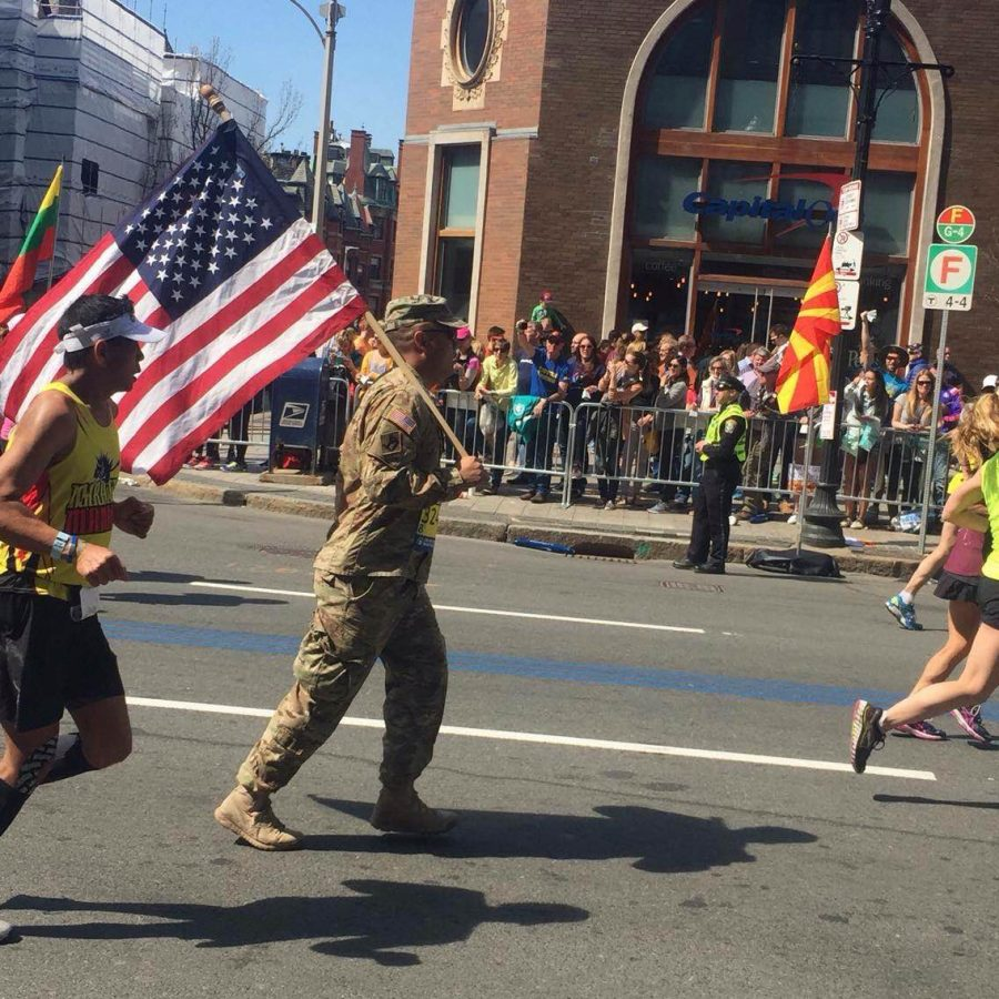 The soldier in the picture above had to run the entire marathon in his uniform with the flag.