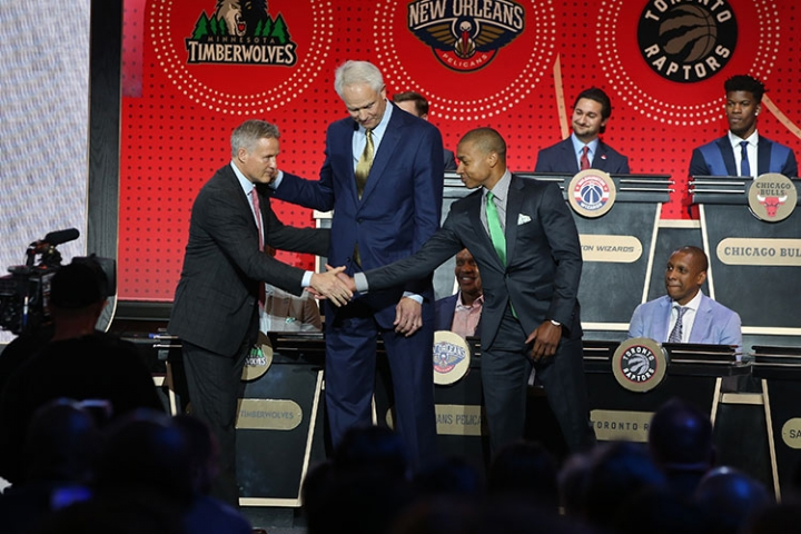 Cletic Isaiah Thomas shakes hands with Brett Brown, the 76ers lottery rep, after the 76ers won the first overall pick.