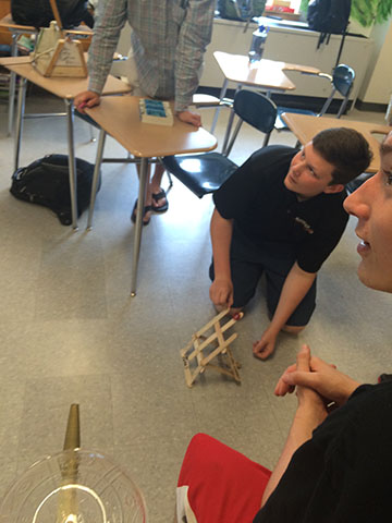Tim Shafter takes a distance shot with his  popsicle stick catapult.
