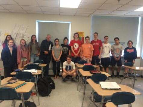 Mr. Mulry poses with his G block class. Freshamn Leah O'Rourke stands to his immediate right.