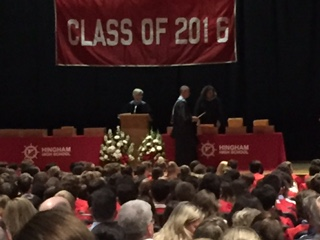 Mr. Swanson presents a student with their award in front of the packed auditorium.