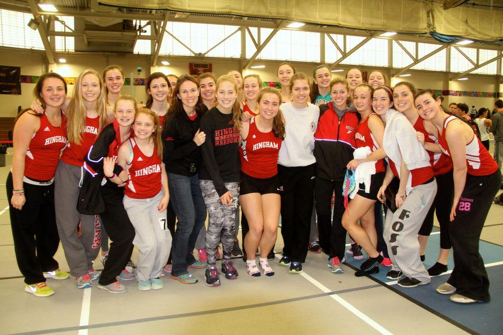 Members of the Hingham High indoor track and field pose after winning the Division 3 State relay championship at the Reggie Lewis Center in Boston on January 17, 2016.