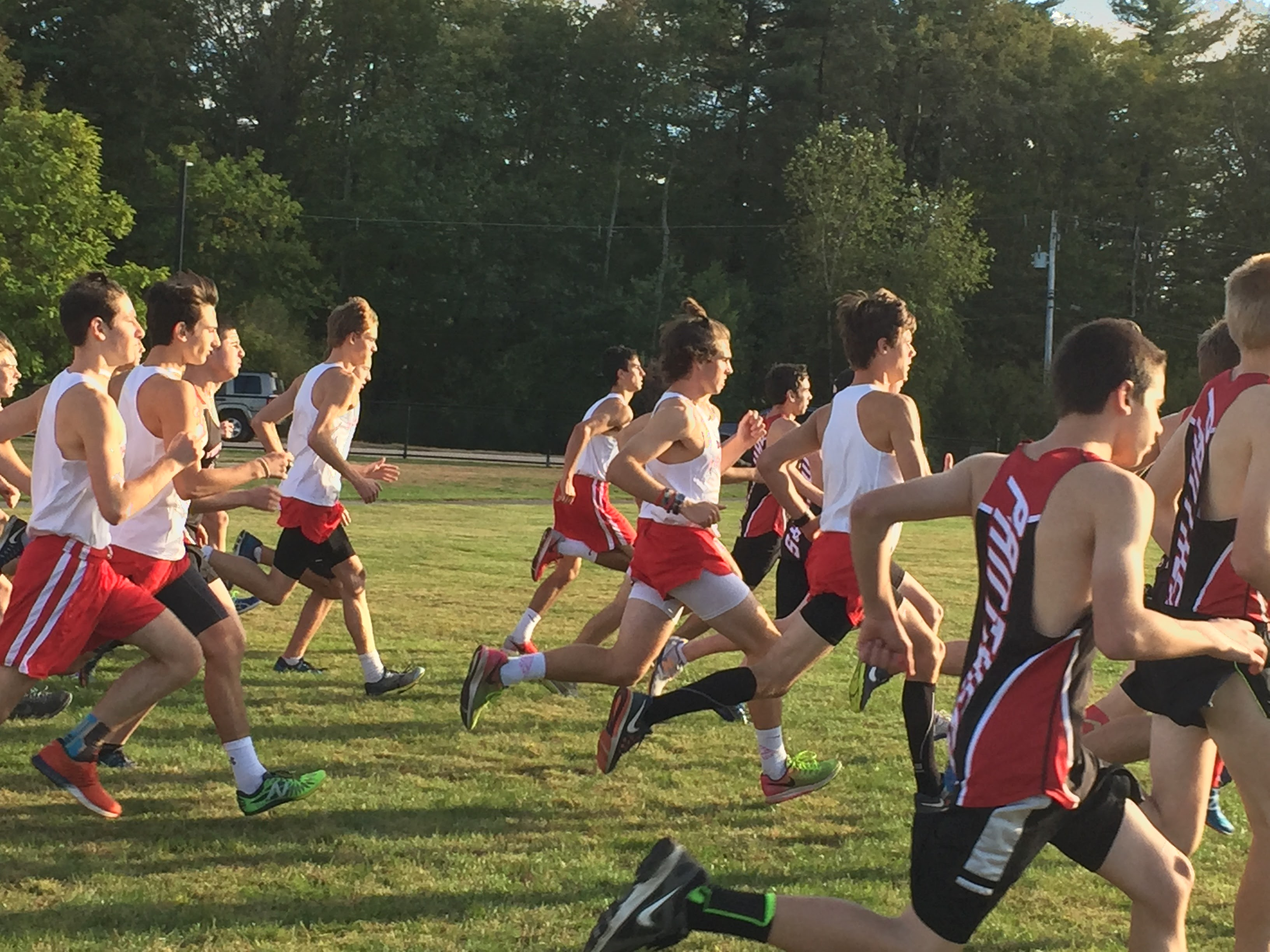 The beginnings of the boys race goes off with a bang as they jump off the starting line.