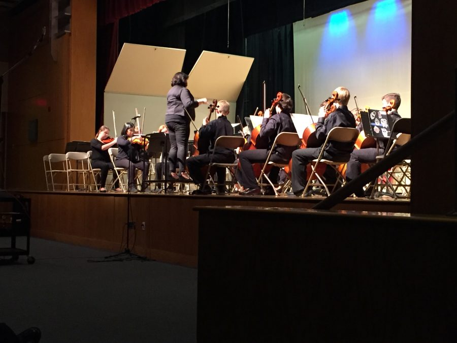 Strings Director Ms. Sassano conducts the freshmen orchestra.