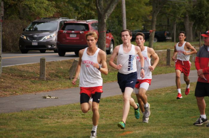 Junior Sam Oomen-Lochtefeld, Senior Scott Myers, and Sophomore Zack Passios (left to right) during their race.