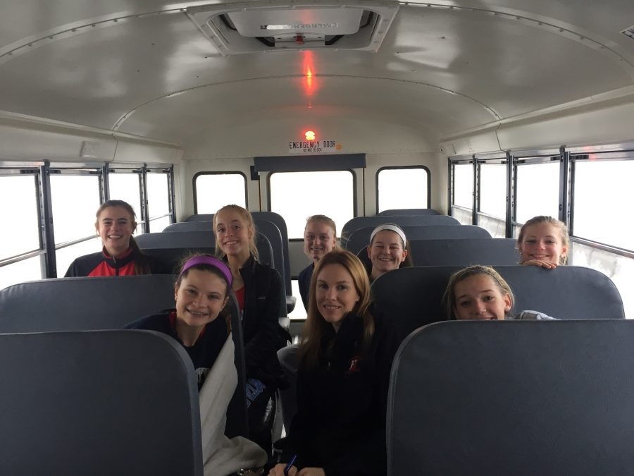 The bus ride home, athletes and coach Diedricksen are all smiles from a successful day.