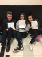John Joyce, Kate Farrell, and Sarah Calame (left to right) enjoying a round of physics studying!