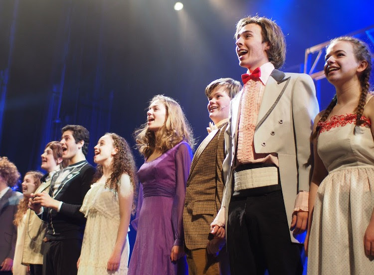 The cast of Carrie performs their finale number before taking a bow.