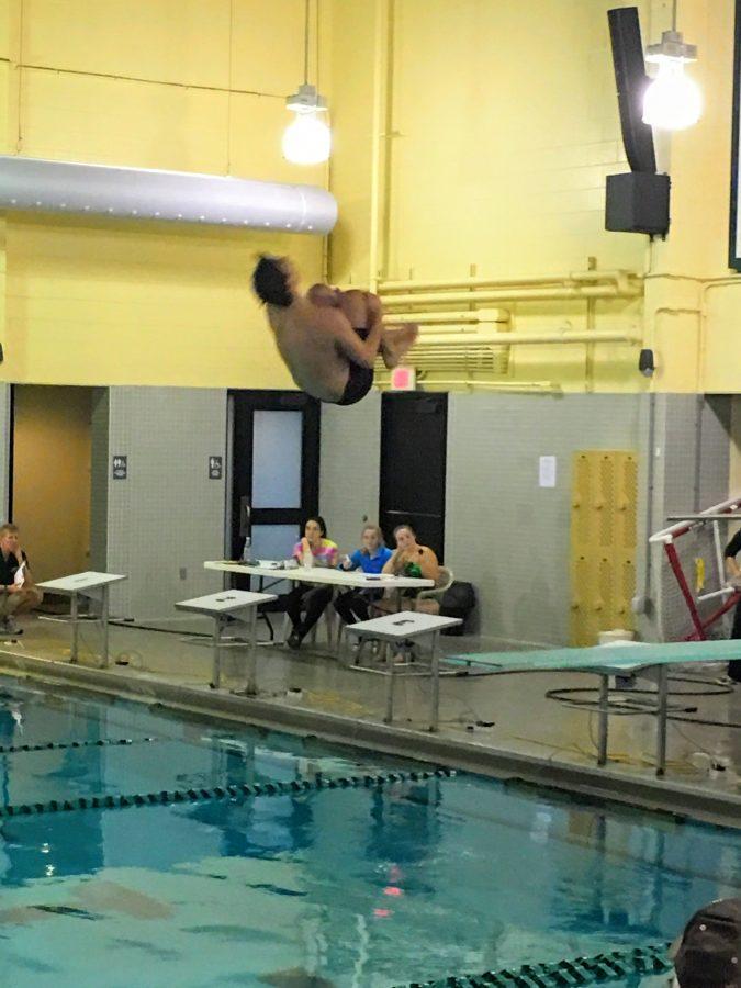 Hingham+Diver+Jackson+Carroll+performs+a+back+tuck+dive.