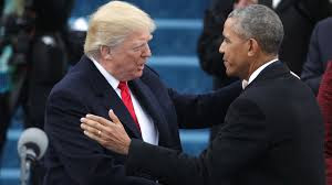Former President Barack Obama shakes hands with President Donald Trump.