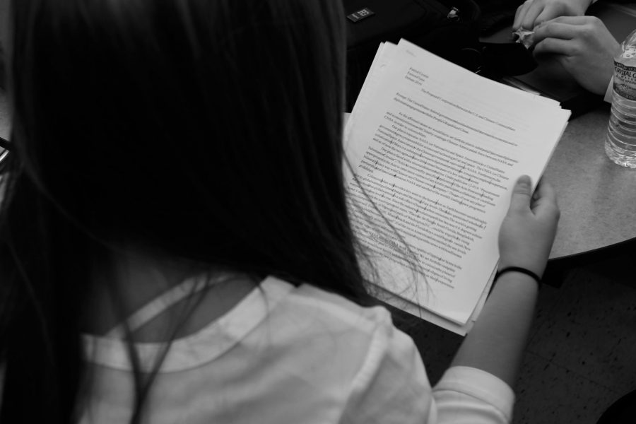 Sophomore Perrin O'Cone reads over her affirmative plan. The Novice Debater explained,