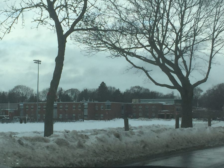A large snowstorm left Hingham High covered with snow, enveloping fields with white.
