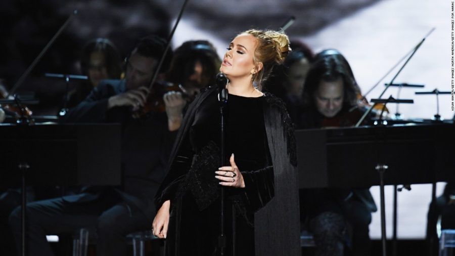 Adele performs tribute to George Michael.